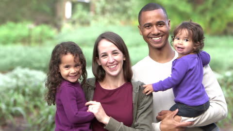 interracial family standing outdoors together - mixed race person stock videos & royalty-free footage