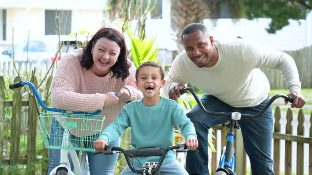 interracial family with little boy on their bicycles - sitting stock videos & royalty-free footage