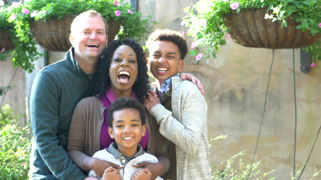 interracial family with two boys in park - 12 13 years stock videos & royalty-free footage