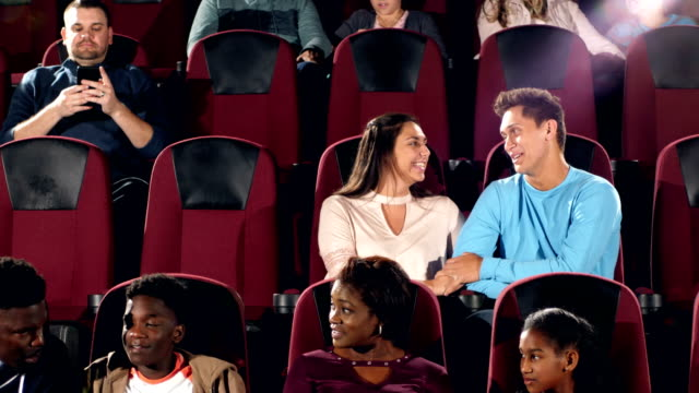 interracial teenage couple in movie theater, talking - teenage couple stock videos & royalty-free footage