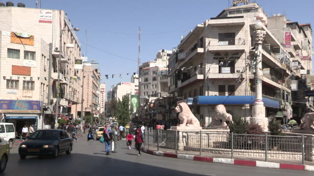 intersection and traffic, ramallah, palestine - traffic点の映像素材/bロール