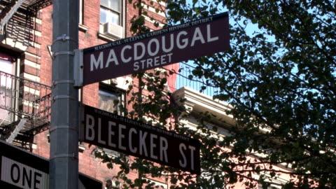 intersection of macdougal street & bleecker street - greenwich village nyc - greenwich village stock videos & royalty-free footage