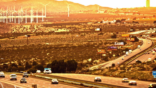 LS T/L Interstate 10 and wind farm in California desert near Palm Springs at the foot of San Jacinto Mountains with desert vegetation