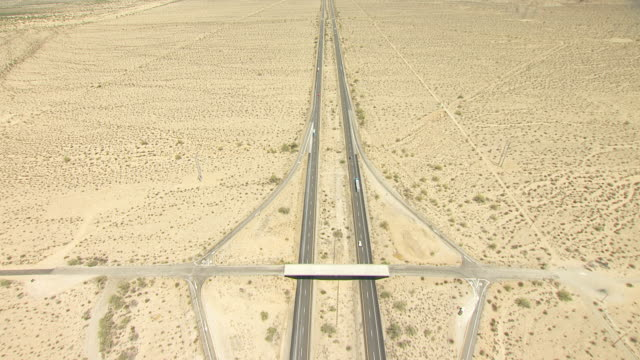 ws tu aerial pov interstate 10 cutting across desert valley with foothills and mountain ranges in distance / california, united states - interstate 10 stock videos & royalty-free footage