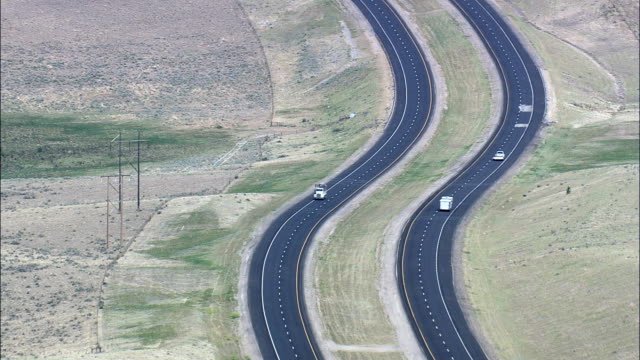 interstate 15 to butte  - aerial view - montana,  silver bow county,  helicopter filming,  aerial video,  cineflex,  establishing shot,  united states - butte rocky outcrop stock videos and b-roll footage