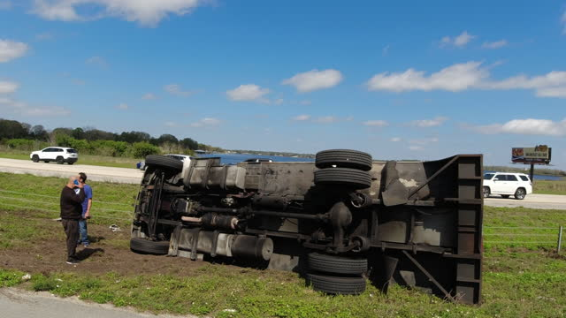 interstate 4 highway road to orlando, a truck flipped over, bystanders were trying to help. - heavy goods vehicle stock videos & royalty-free footage