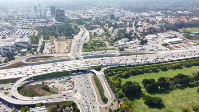 interstate 405 and los angeles cityscape -  aerial view - westwood neighborhood los angeles stock videos & royalty-free footage