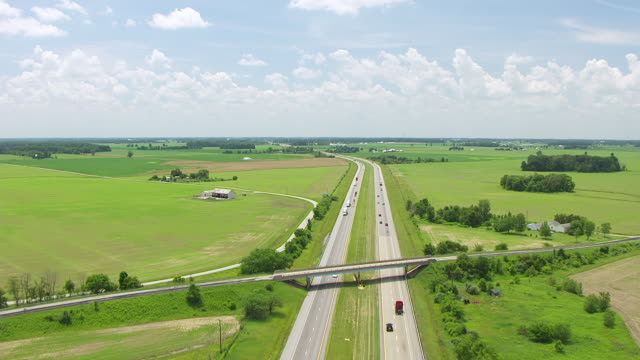 ws tu aerial pov interstate 69 passing through farmlands / huntington county, indiana, united states - indiana stock videos & royalty-free footage
