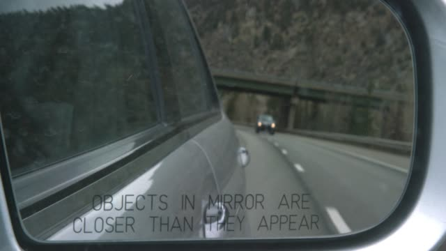 interstate 70 and the rocky mountains of colorado reflected in a car's side view mirror (objects in mirror are closer than they appear) - man made object stock videos & royalty-free footage