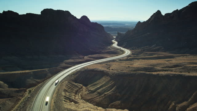 interstate 70 winding through dramatic utah landscape towards the san rafael reef - drone shot - san rafael swell stock videos and b-roll footage