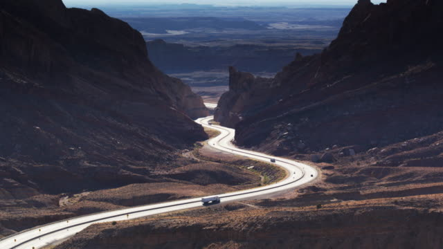 interstate 70 winding through the san rafael reef - aerial shot - san rafael swell stock videos and b-roll footage