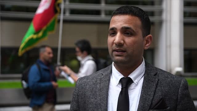 interview ahmed nawid, former interpreter, about protest to urge government to help evacuate people in afghanistan who worked with allied forces... - domestic room stock videos & royalty-free footage