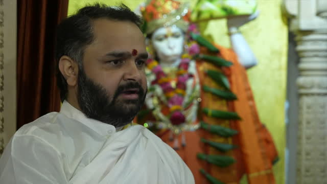interview bhavik pandya, hindu priest, about praying for the people in india, and all people, suffering during the coronavirus pandemic - place of worship stock videos & royalty-free footage