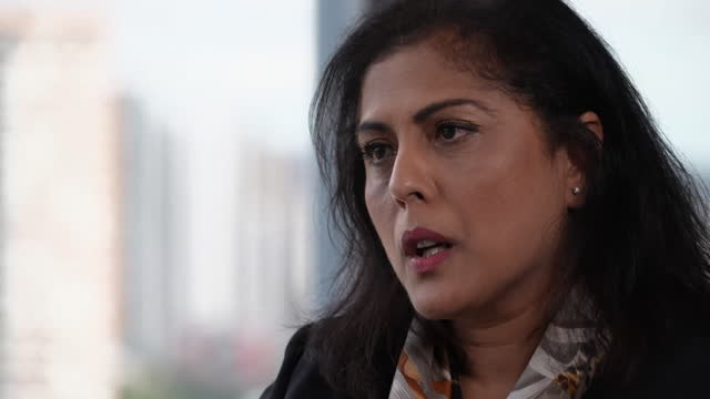 """interview bina mehta, kpmg uk, about wanting to increase the amount of employees from working class backgrounds - """"bbc news"""" stock videos & royalty-free footage"""