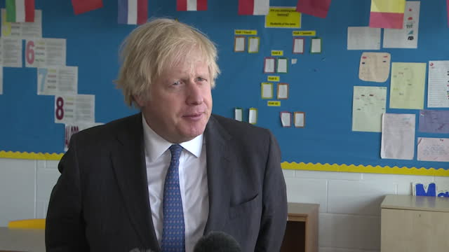interview boris johnson pm, about the possibility of covid-19 vaccine passports of certificates for domestic use - examining stock videos & royalty-free footage
