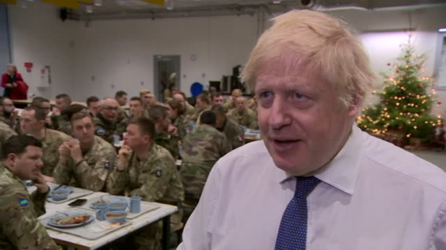 interview boris johnson pm defends decision to sell british defence company cobham to an american private equity firm whilst visiting british troops... - イギリス国防省点の映像素材/bロール