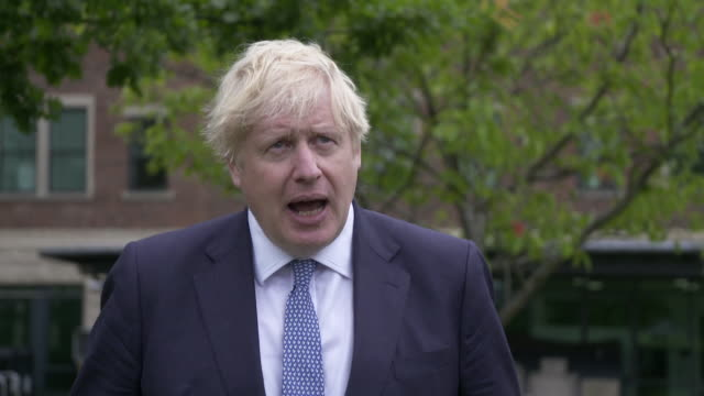 interview boris johnson pm on the amount of excess deaths experienced by england during coronavirus pandemic we owe it to them to continue to drive... - wisdom stock videos & royalty-free footage