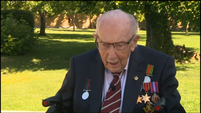 """interview captain sir tom moore awarded knighthood for fundraising during the coronavirus crisis on how he will kneel down to the queen - """"bbc news"""" stock videos & royalty-free footage"""