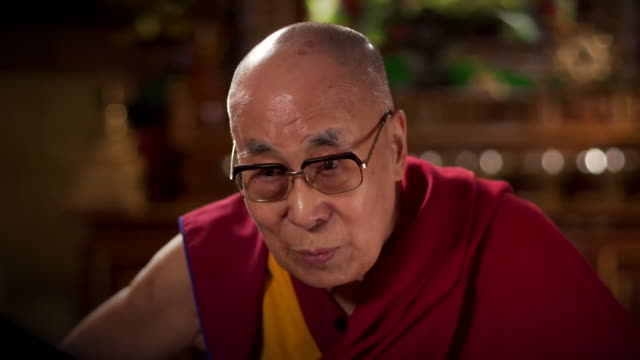interview dalai lama about his comments on why a female successor must be attractive - image stock videos & royalty-free footage