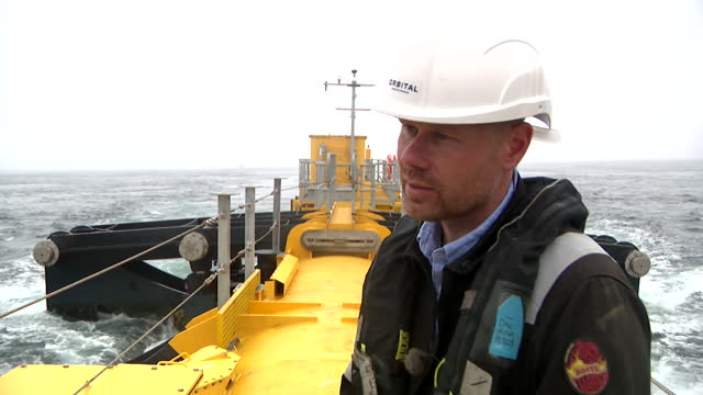 """interview daniel wise, orbital marine power, about the o2 tidal turbine connected to the electricity grid off the coast of orkney, being the most... - """"bbc news"""" stock videos & royalty-free footage"""