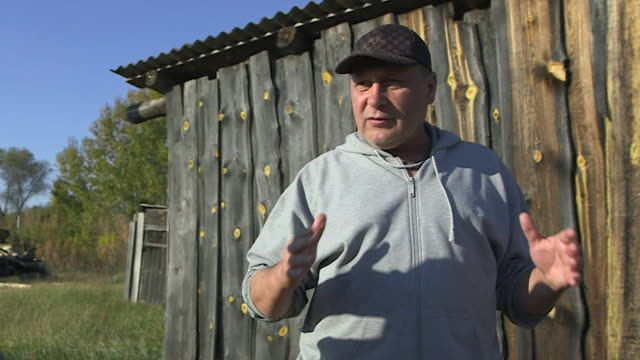 interview dr gennady laptev about atomik vodka made from ingredients grown in the chernobyl exclusion zone we can use this land in diverse way and... - environmental damage stock videos & royalty-free footage