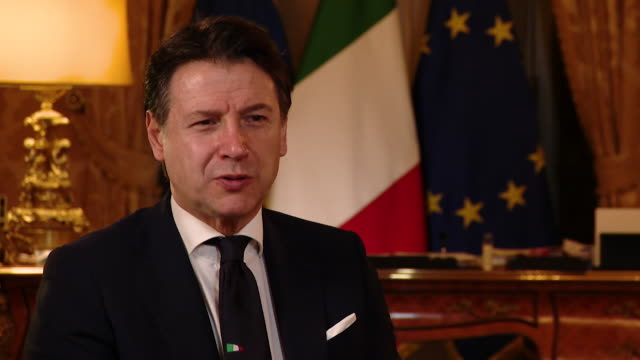 """interview giuseppe conte italian prime minister sends his best wishes to pm boris johnson who is fighting coronavirus in hospital don't give up boris - """"bbc news"""" video stock e b–roll"""