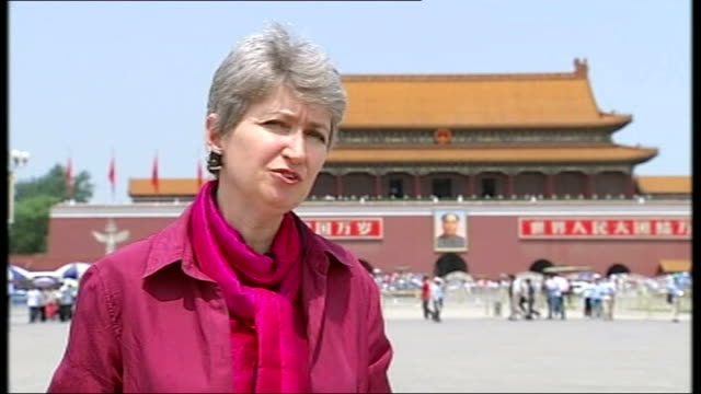 interview government official on tiananmen square massacre; reporter to camera - tiananmen square massacre stock videos & royalty-free footage