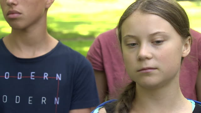 interview greta thunberg climate change campaigner in geneva says it feels like many older people don't care as they feel it won't affect them... - aktivist stock-videos und b-roll-filmmaterial