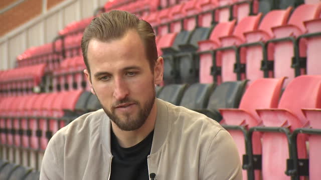 interview harry kane, england captain, about sponsoring leyton orient football shirt then donating the space to a charity - competition stock videos & royalty-free footage