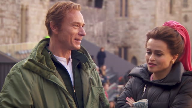 interview helena bonham carter and ben daniels, on the set of the crown at caernarfon castle, as they play lord snowdon and princess margaret, talk... - stately home stock videos & royalty-free footage