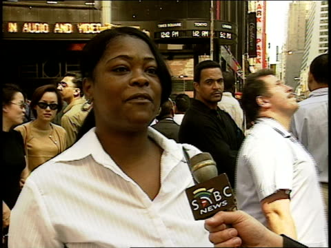 interview hours after attack w/ black woman horrified by people jumping / falling from wtc towers & the attack in general; times square. crowd of... - september 11 2001 attacks stock videos & royalty-free footage