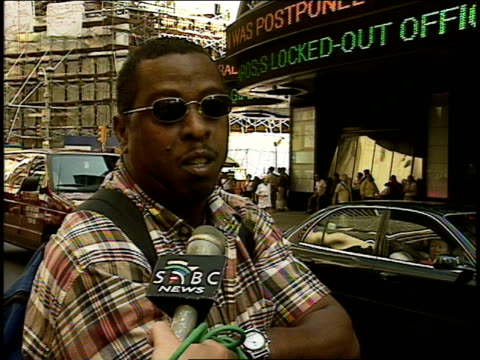 interview hours after attack w/ west indian black man wearing sunglasses in times square; describes his horrified & saddened reaction. news headlines... - september 11 2001 attacks stock videos & royalty-free footage