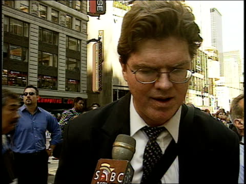 9/11/01 SABC interview hours after attack w/ White man wearing eyeglasses in Times Square describes his experience of watching towers collapse 'most...