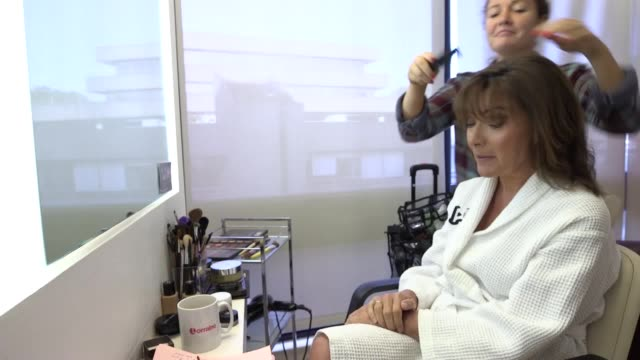interview in the makeup chair with presenter lorraine kelly as she prepares for her show. itv's morning program lorraine airs fridays from 8:30am. - lorraine kelly stock videos & royalty-free footage