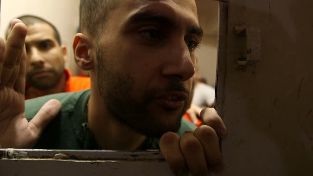 interview ishak moustafoui captured islamic state fighter in kurdish controlled syrian prison stuff needs to be provided as rights as a prisoner we... - siria video stock e b–roll