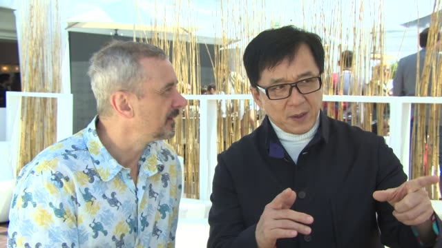 interview - jackie chan on having so many ideas, getting fan bingbing involved at 'skiptrace' interviews at carlton beach on may 17, 2013 in cannes,... - jackie chan stock videos & royalty-free footage