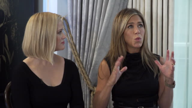 interview jennifer aniston and reese witherspoon talk about working in the morning show together and how the script changed to incorporate issues... - friendship stock videos & royalty-free footage