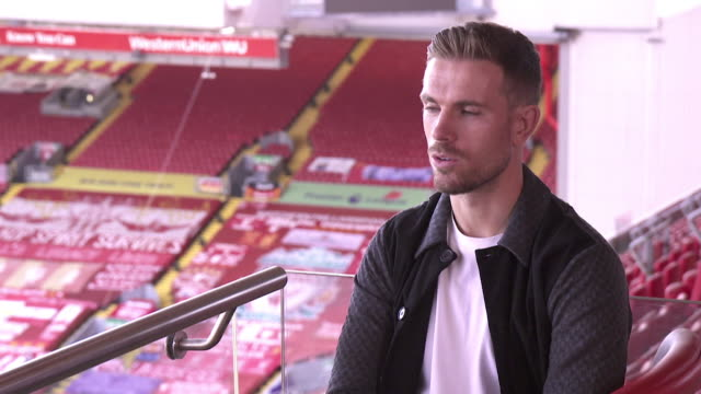 interview jordan henderson, liverpool fc captain, about fans needing to stay at home as liverpool fc are awarded the premier league winners trophy,... - competition stock videos & royalty-free footage