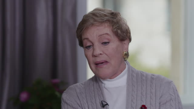 interview julie andrews, actress, talks about being unable to sing anymore but using her voice in a different way by writing books - julie andrews stock videos & royalty-free footage