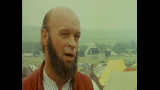 interview michael eavis, founder of glastonbury festival, about complaints and complimentary tickets to villagers of pilton - 創始者点の映像素材/bロール