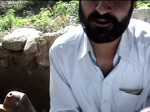 interview of man about hashish and its importance within pashtun society, swat district in tribal zone at afghan border, pir baba village, federally... - only mid adult men stock videos & royalty-free footage