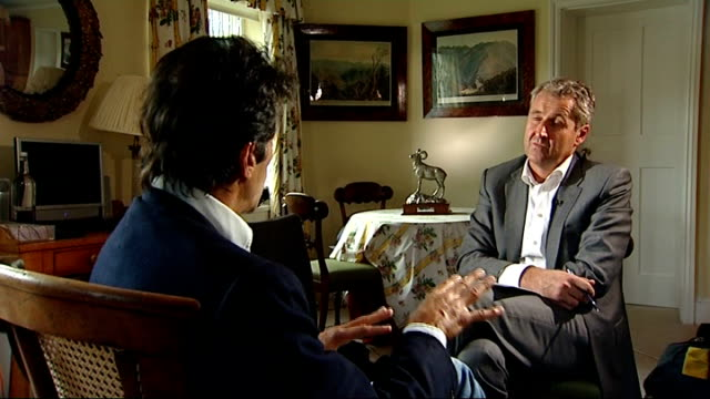 interview pakistani politician imran khan on situation in afghanistan; england: london: richmond: int set-up shots of reporter with imran khan imran... - an answer film title stock videos & royalty-free footage