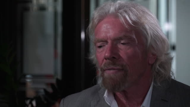 interview richard branson, businessman, about climate change and reducing carbon output, particularly in regards to air travel - fumes stock videos & royalty-free footage
