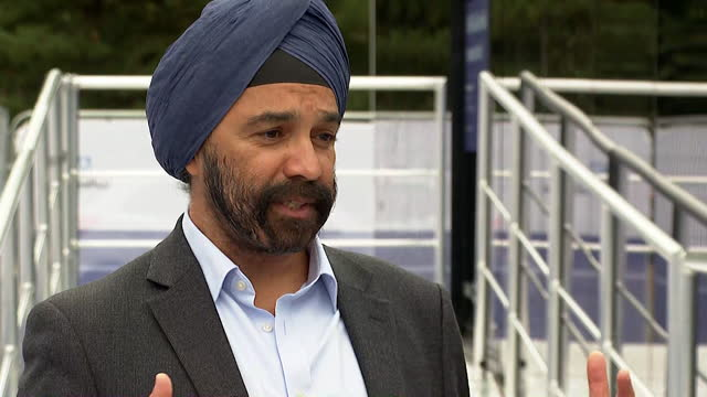 """interview sir harpal kumar, president grail europe, about large clinical trial that uses a blood test to detect cancer before symptoms appear - """"bbc news"""" stock videos & royalty-free footage"""