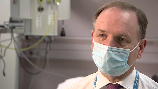"""interview sir simon stevens, ceo nhs england, about the success of the covid-19 vaccination rollout """"it has been an amazing team effort"""" - teamwork stock videos & royalty-free footage"""