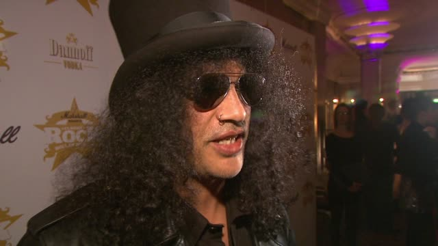 Slash on presenting an award at the Classic Rock Roll Of Honour Awards at London England