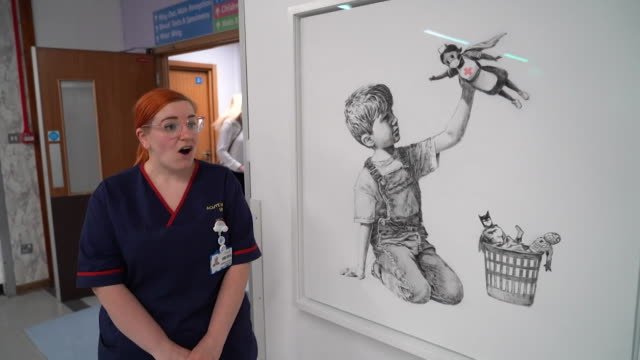 interview stephanie gurney, senior sister, acute medical unit, about banksy artwork to recognise work of nhs during coronavirus crisis, displayed at... - held stock-videos und b-roll-filmmaterial
