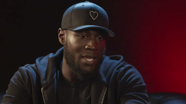 "interview stormzy, rapper and singer, about appearing in video game watchdog legion ""whatever medium we use as artists, it's a medium to speak out... - musician stock videos & royalty-free footage"