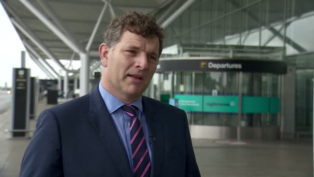 interview tim hawkins stansted airport about not understanding the government's approach to imposing a two week quarantine to people travelling from... - reportage stock videos & royalty-free footage
