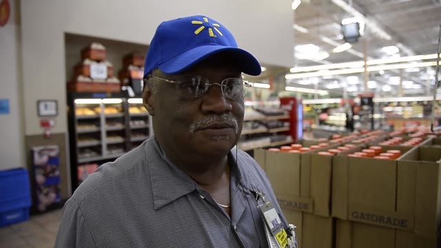stockvideo's en b-roll-footage met interview walmart employee willie walker talks about his experience working long years at the store on may 30 2013 in pico rivera california walmart... - wal mart